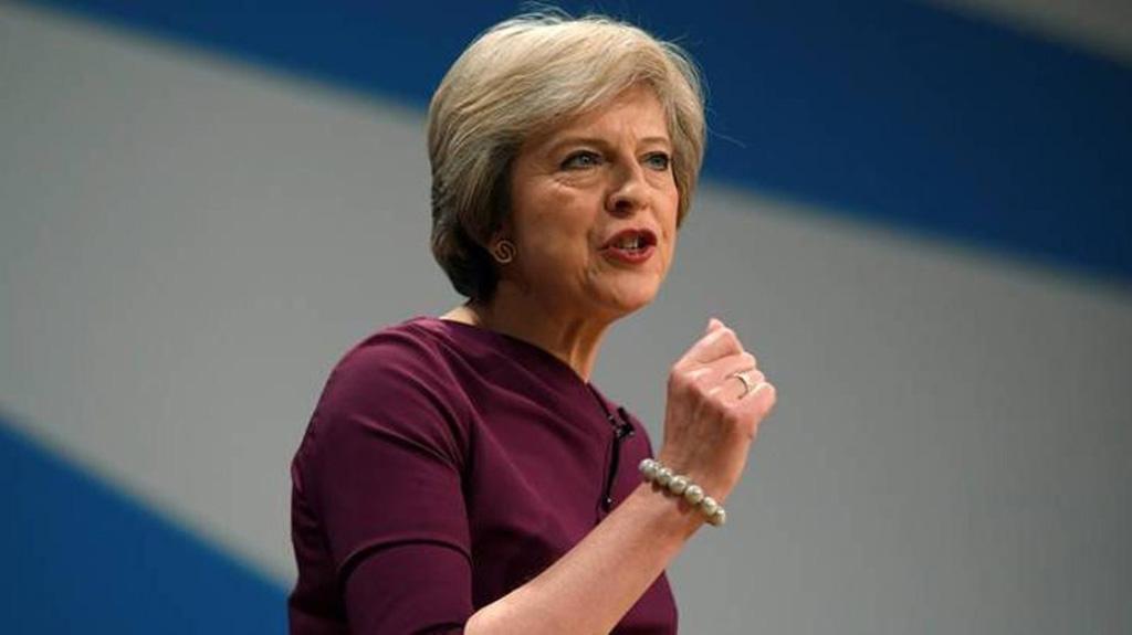 رئيسة وزراء بريطانيا تهدد متمردي حزبها بالدعوة لانتخابات عامة